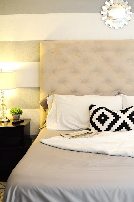 A monochromatic bedroom provides a relaxing haven, especially when you add a tufted headboard!