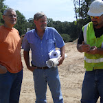 conferring with the project manager and a subcontractor