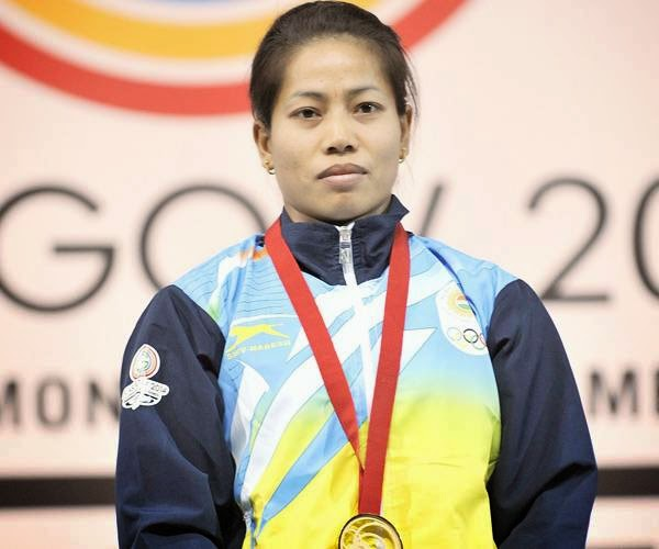 India's gold medalist Sanjita Chanu Khumukcham celebrates with her medals on the podium at the medal ceremony for the women's weightlifting 48kg class at the SECC Precinct during the 2014 Commonwealth Games in Glasgow, Scotland on July 24, 2014.