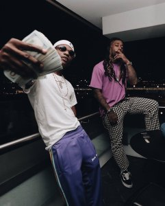 Wizkid and TY Dolla Sign Flaunts Tons Of Dollars In New Photo