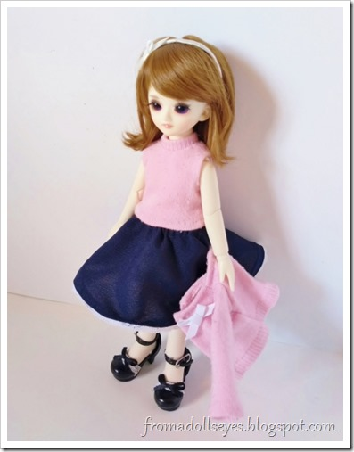 Underneath the cute pink sock sweater, the doll is wearing a sleeveless knit top to match.  It makes for a classic sweater set.