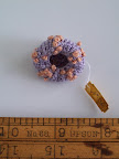 If you don't know how to crochet, then you can purchase some creatures already made. http://www.etsy.com/listing/62897174/crocheted-sea-urchin-pin