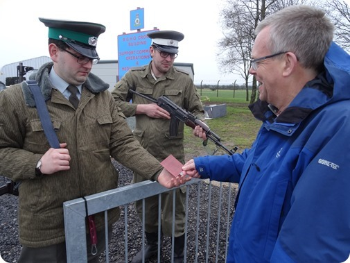 Visitor Mark Ray has his papers checked by East German   border guards