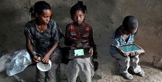 Ethiopian kids with tablet computers