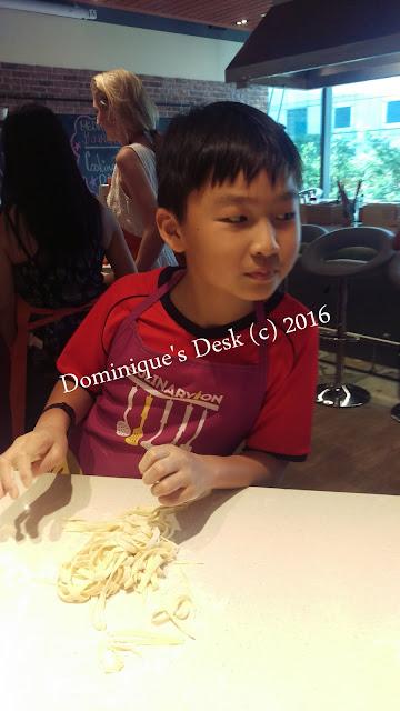 Monkey boy examining the pasta