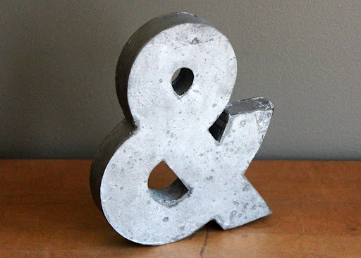 Zinc ampersand available for rent from www.momentarilyyours.com, $1.50.
