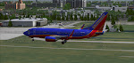 Landing runway 36R at Tampa FL.  The International Plaza and Bay Street supplies the background.
