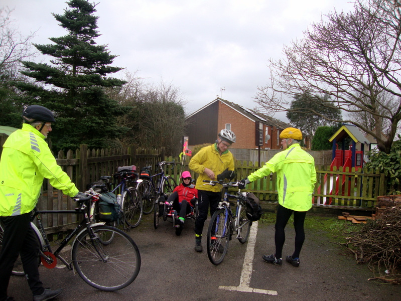 Cyclists in bright jackets