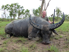Mr Reardon, Australia with 100SCI point bull. Taken with a double rifle one rainy December day.