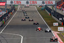Romain Grosjean, Lotus E22 Renault, leads Valterri Bottas, Williams FW36 Mercedes, and Kimi Raikkonen, Ferrari F14T