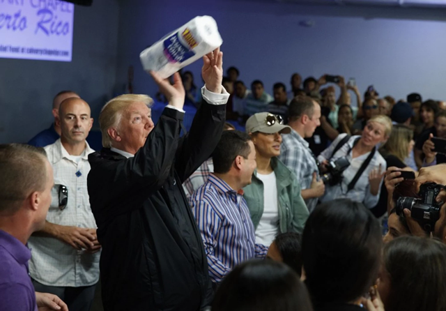 Trump tosses paper towels into a crowd at Calvary Chapel in Guaynabo, Puerto Rico, on 3 October 2017. Photo: Evan Vucci / AP