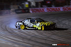 Brad McQueen drifting in the Nissan S14 Ouch Tattoo car