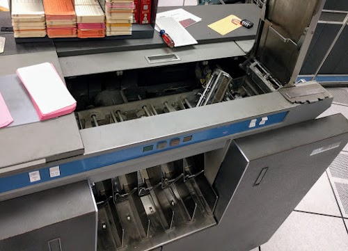 The IBM 1401's card reader was experiencing errors, so we removed the brushes and realigned them.