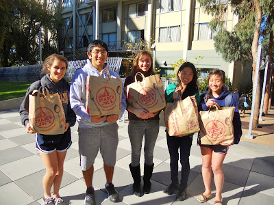 Community Health committee returning from a trip to Trader Joe's with plenty of supplies to feed the hungry.