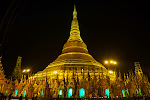 Yangon's Schwedagon Pagoda - It's a 99 metres (325 ft) gilded pagoda and stupa located in Yangon, Burma. The pagoda lies to the west of Kandawgyi Lake, on Singuttara Hill, thus dominating the skyline of the city. It is the most sacred Buddhist pagoda for the Burmese with relics of the past four Buddhas enshrined within: the staff of Kakusandha, the water filter of Koṇāgamana, a piece of the robe of Kassapa and eight strands of hair of Gautama, the historical Buddha.