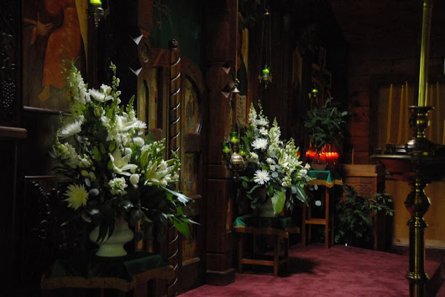 Flowers adorning the iconostasis.