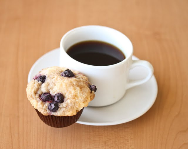 photo of a cup of coffee with a Blueberry coffee cake muffins