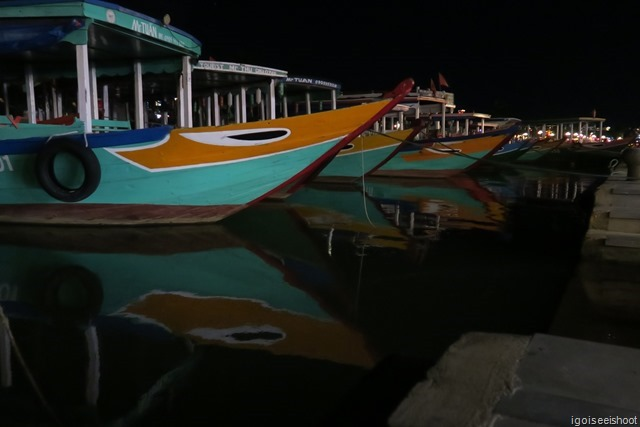 River boats at the pier next to the Central Market at night.