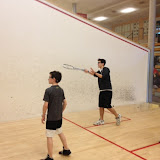 Kidsquash players get instruction from volunteer peer coach Octavio Chiesa.  (March 2013 photo)