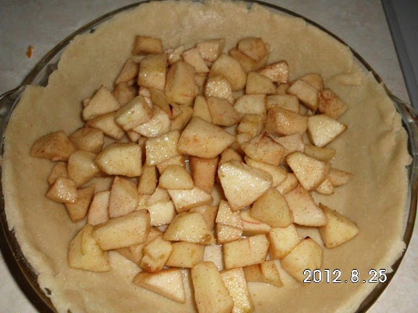 Drain any juice that the apple may have created.  Pour apples into pie...
