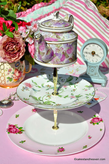 vintage mismatched pink cake stand with teapot top
