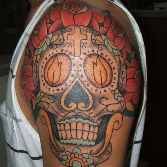 Rose-petals-and-sugar-skull-tattoo-for-men