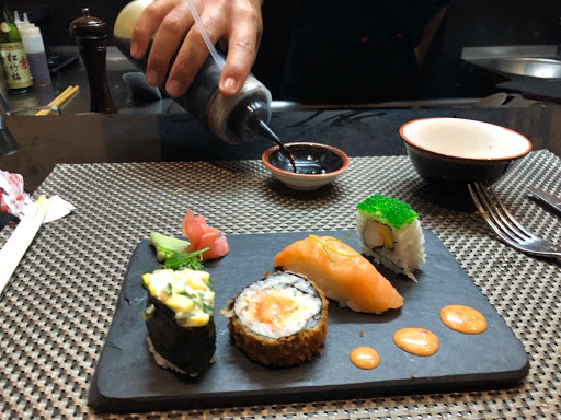 Californian sushi roll, salmon nigiri , futamaki and avocado Maki