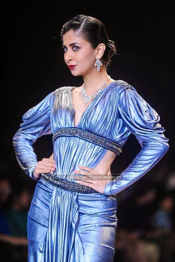 A model showcases a creation for Gitanjali on Day 2 of India International Jewellery Week (IIJW), 2014, held at Grand Hyatt, in Mumbai.<br /> <br />