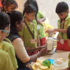 Juice making Activity in Sr.Kg for the Theme of this month Fruits and Vegetables (2014-15)