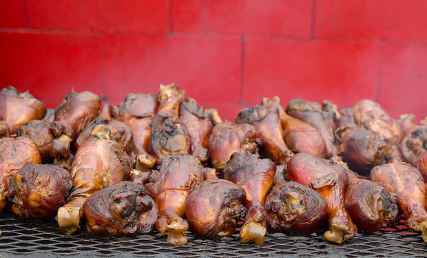 photo of Giant Smoked Turkey Legs on a grill
