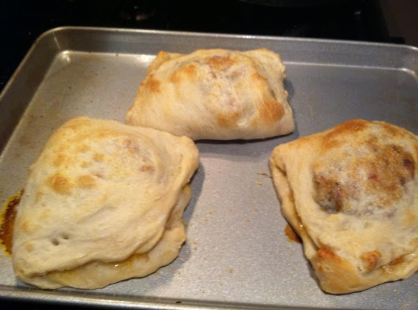 IN A PREHEATD OVEN TO 425 BAKE SAUSAGE N PEPPER CALZONES FOR 20 MINUTES...