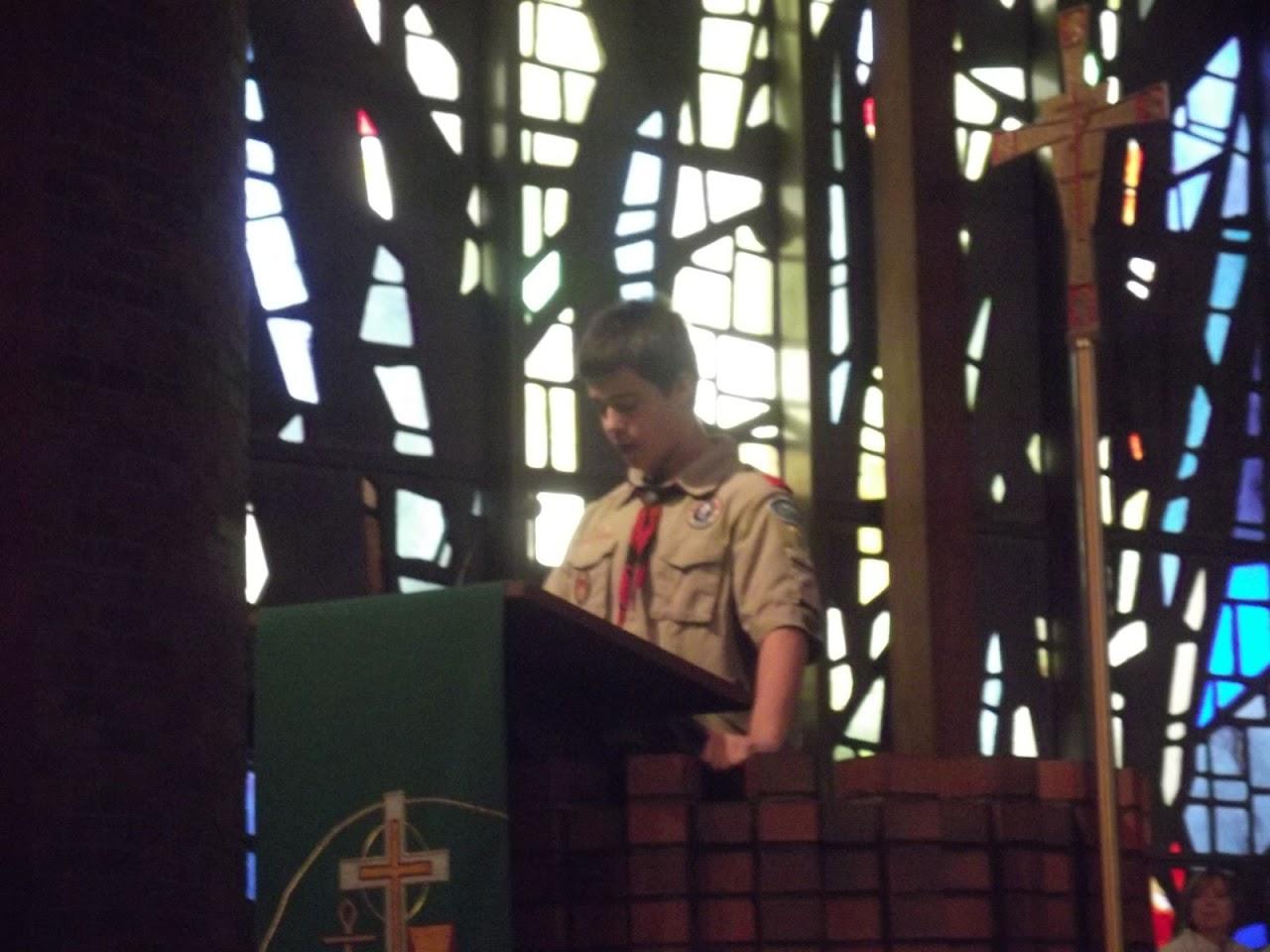 Matthew reading about Scout Sunday