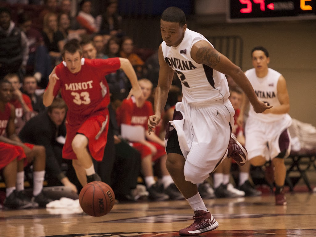 Kevin Henderson breaks towards the paint after Montana's stifling full-court press yielded the last of his four steals Wednesday evening.  Dahlberg Arena in Missoula, Mont., November 14th, 2012.