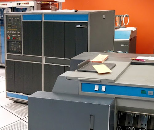 The IBM 1401 computer. The card reader/punch is in the foreground. The 12K memory expansion box is partially visible to the right behind the 1401.