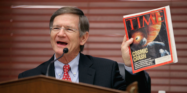 Rep. Lamar Smith (R-TX), chairman of the U.S. House Committee on Science, Space and Technology, holds a copy of TIME magazine. He is targeting climate science in the U.S. EPA. Photo: Getty