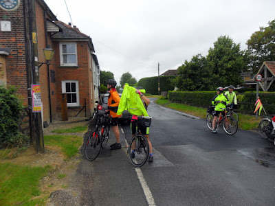 cyclists look at a house