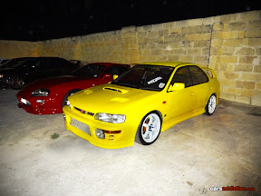 Yellow Subaru Impreza