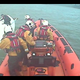 Poole inshore lifeboat crew arriving on scene to help a dinghy sailor who had been struggling to right his capsized dinghy for 1 hour - 26 April 2014 Photo: RNLI Poole