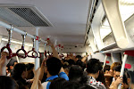 Crowded is the key word in the urban areas of nation of a 1.4 billion people. This is a regular ride through Guangzhou's metro system. People tend to shove each other to get into public transport when the doors open.