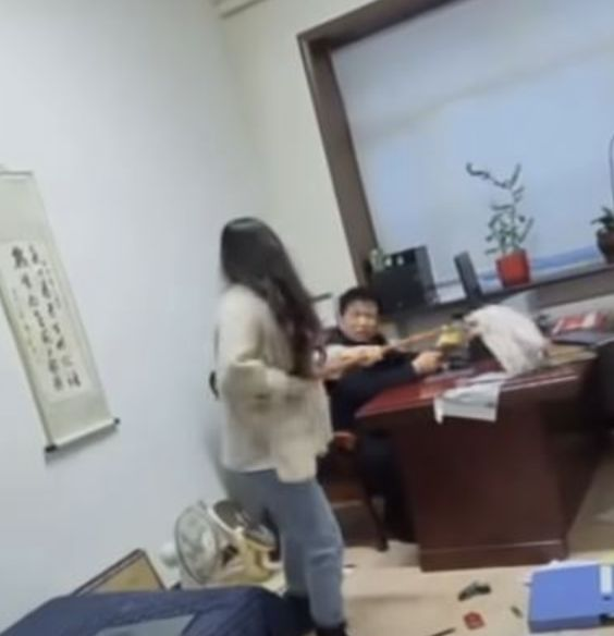 Woman Beats Up Her Boss With A Mop Stick For Sending Inappropriate Texts (Photos)