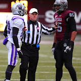 A referee separates the Grizzlies' Kavario Middleton, 85, and the Bears' Jestin Love, 28, after a heated exchange.