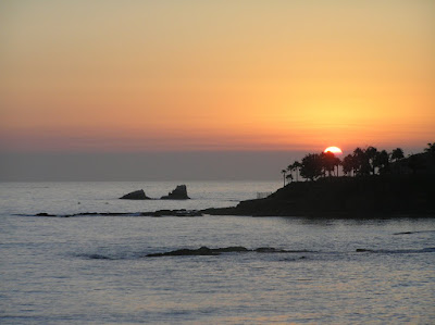 Photo of the sunset at Laguna Beach. While the sun was going down, the night was just about to get started. Photo taken on August 16, 2007.