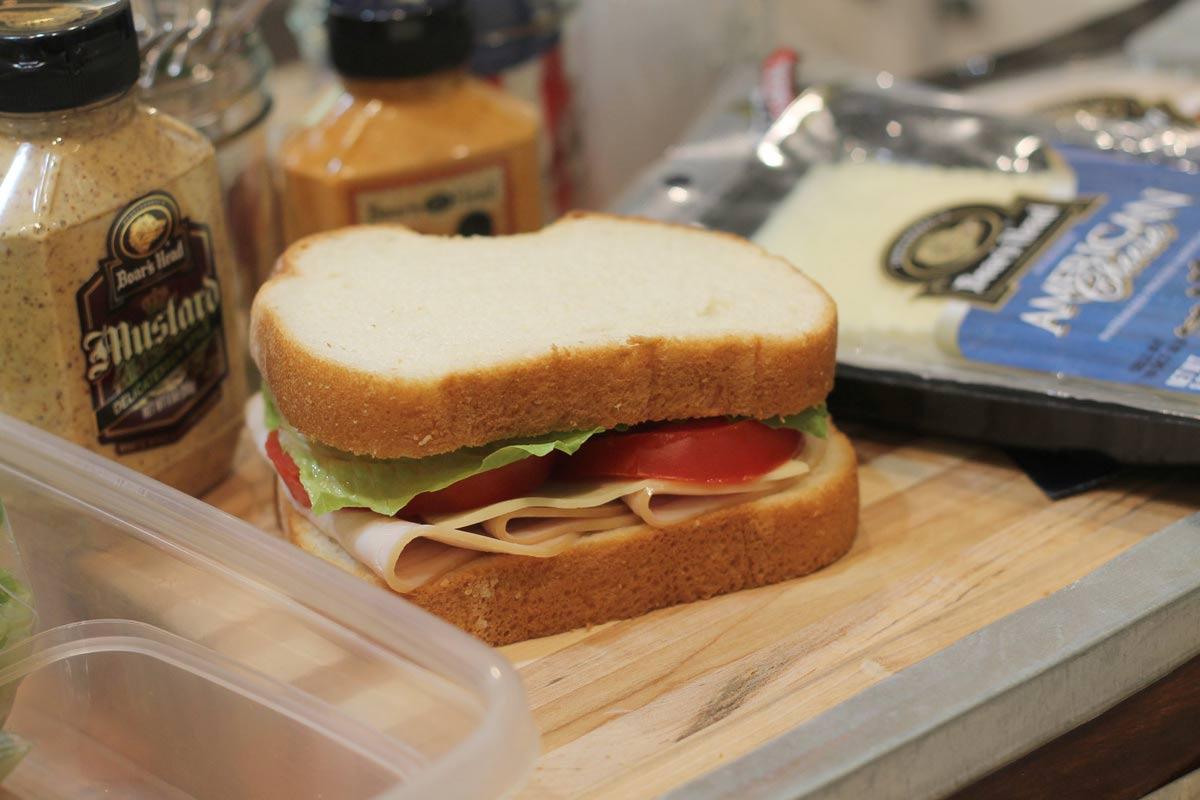 Kids making turkey sandwich
