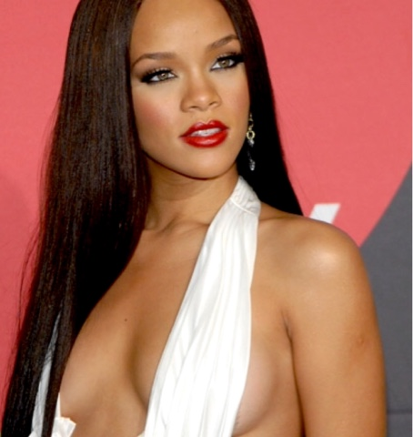 Rihanna attends the Billboard Music Awards wearing Zac Posen, Norma Kamali and Max Azria