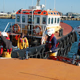 The crew prepare to transfer a stretcher from the ALB to the tug - Training exercise, 19 February 2012