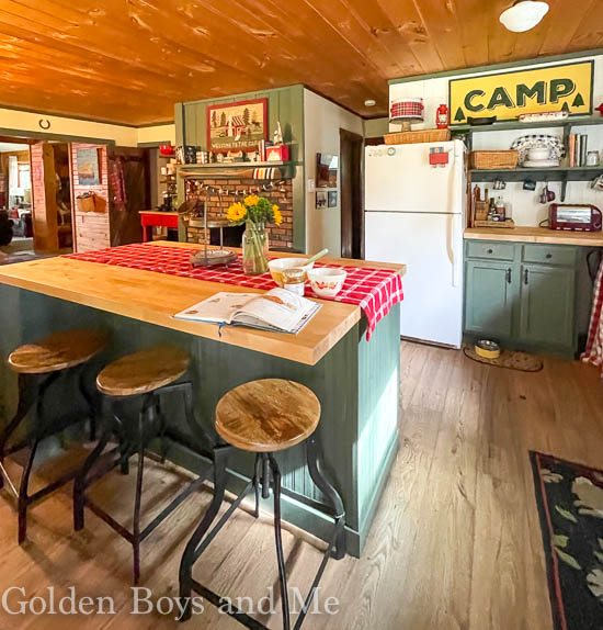 Cabin kitchen with fireplace and Benjamin Moore Backwoods paint - www.goldenboysandme.com