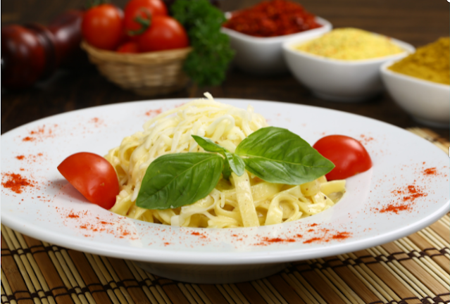 Classic Fettucine Alfredo tossed with basils and tomatoes
