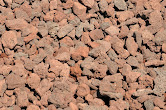 """3/4"""" Red Cinder - Also known as Red Lava Rock, primarily used as decorative rock for yards. Many mobile home parks in the area do not allow barkdust and this is a favored alternative."""