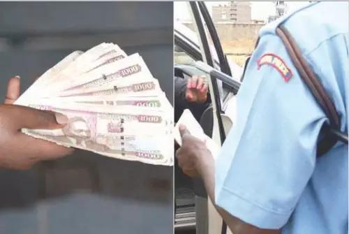 Police Officer caught collecting money. PHOTO | BMS
