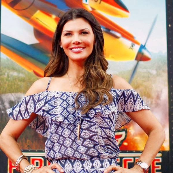 Actress Ali Landry poses after arriving at the premiere of 'Planes: Fire & Rescue' at the El Capitan Theater in the Hollywood section of Los Angeles, California, July 15, 2014.